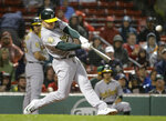 Oakland Athletics' Matt Chapman hits a two-run double off Boston Red Sox starting pitcher Eduardo Rodriguez during the first inning of a baseball game Tuesday, May 15, 2018, in Boston. (AP Photo/Steven Senne)