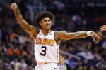 Phoenix Suns forward Kelly Oubre Jr. (3) motions to the officials during the first half of an NBA basketball game against the Utah Jazz, Monday, Oct. 28, 2019, in Phoenix. (AP Photo/Matt York)