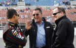 FILE - In this Feb. 11, 2007, file photo, NASCAR driver Juan Pablo Montoya, left, of Colombia, shares a laugh with co-owners Felix Sabates, center, and Chip Ganassi as they wait for qualifying for the Daytona 500 auto race, at Daytona International Speedway in Daytona Beach, Fla. Felix Sabates is leaving NASCAR after 30 years as a team owner. The Cuban refugee came to the United States at 15 and built a lucrative business that allowed him to enter NASCAR in 1989. (AP Photo/Glenn Smith, File)