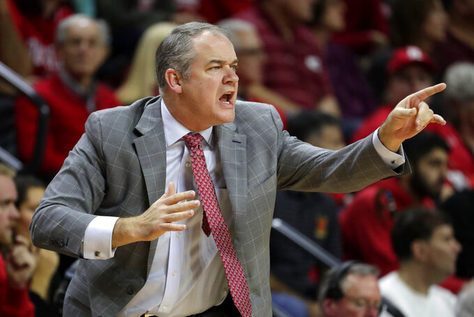 Rutgers head coach Steve Pikiell talks to his team during the first half of an NCAA college basketball game against Maryland, Saturday, Jan. 5, 2019, in Piscataway, N.J. (AP Photo/Julio Cortez)