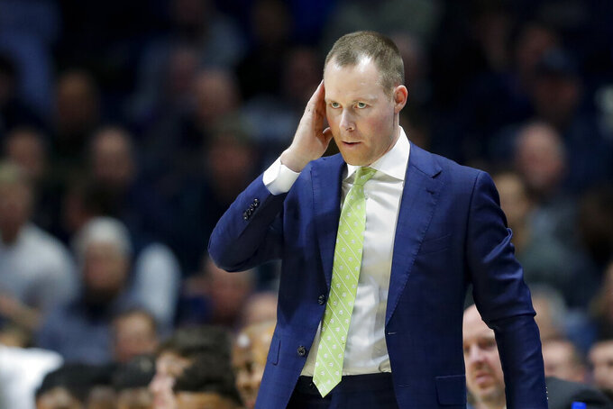 Xavier head coach Travis Steele reacts during the first half of an NCAA college basketball game against Seton Hall, Wednesday, Jan. 8, 2020, in Cincinnati. (AP Photo/John Minchillo)