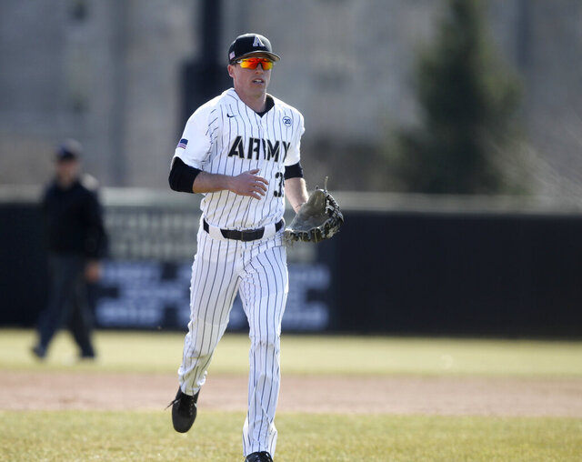 In this 2019 photo provided by Army West Point Athletics, Army NCAA college baseball player Jacob Hurtubise is seen on the field during a baseball game at Johnson Stadium at Doubleday Field in West Point, N.Y. Drafted last year on a late round by the Seattle Mariners, Hurtubise is hopeful of taking advantage of a new regulation that allows cadet-athletes at Army, Navy and Air Force to delay their military obligation upon graduation to pursue professional sports careers. (Mady Salvani/Army West Point Athletics via AP)