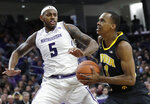 Iowa guard Maishe Dailey, right, drives to the basket against Northwestern center Dererk Pardon during the first half of an NCAA college basketball game Wednesday, Jan. 9, 2019, in Evanston, Ill. (AP Photo/Nam Y. Huh)