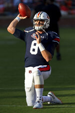 In this Sept. 8, 2018 photo Auburn quarterback Jarrett Stidham (8) warms up before an NCAA college football game against Alabama State in Auburn, Ala. The stage is set for another thriller for LSU at Auburn. Stidham will be challenged by a sack-happy LSU defense that features one of the nation's top cornerbacks in Greedy Williams. (AP Photo/Vasha Hunt)