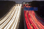 In this long exposure photo, cars drive on a highway in Frankfurt, Germany, early Thursday, Sept. 19, 2019. (AP Photo/Michael Probst)