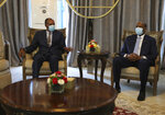 CORRECTS TO MEETS NOT INSPECTING HONOR GUARD - President of the Sudanese Transitional Council General Abdel Fattah al-Burhan, right, and Eritrean President Isaias Afwerki meet in Khartoum, Sudan, Tuesday, May 4, 2021. Afwerki is on a 1-day official visit to Sudan to meet with al-Burhan and other government officials. (AP Photo/Marwan Ali)