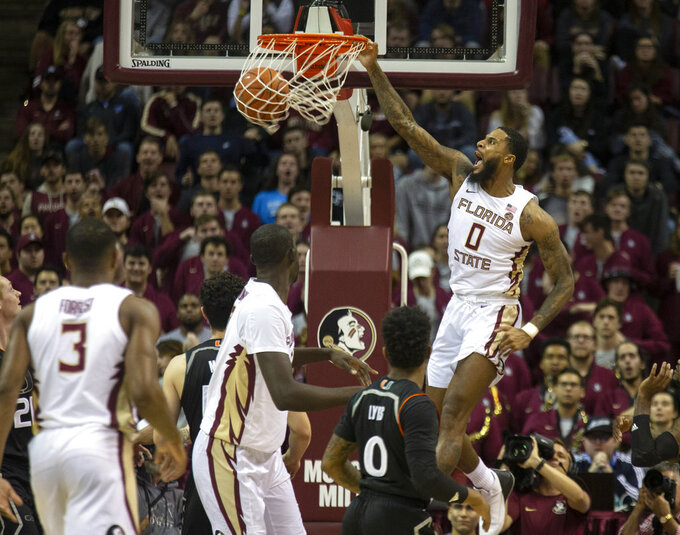 Florida State forward Phil Cofer turns a rebound into a dunk in the first half of an NCAA college basketball game against Miami in Tallahassee, Fla., Wednesday, Jan. 9, 2019. (AP Photo/Mark Wallheiser)