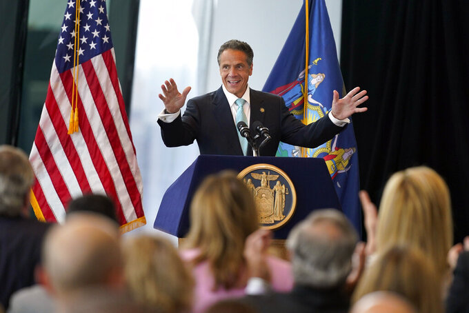 New York Gov. Andrew Cuomo speaks about the lifting of COVID-19 restrictions during a news conference at One World Trade in New York, Tuesday, June 15, 2021. Cuomo said Tuesday that 70% of adults in New York have received at least one dose of a coronavirus vaccine, a threshold he said the state would celebrate by easing many of its remaining social distancing rules and shooting off fireworks.  (AP Photo/Seth Wenig)