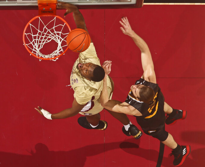Florida State forward RaiQuan Gray (1) is fouled in the back by Winthrop guard Charles Falden (11) as he attempts a layup in the first half of an NCAA college basketball game in Tallahassee, Fla., Tuesday, Jan. 1, 2019. Florida State won 87-76. (AP Photo/Phil Sears)