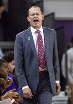 East Carolina Head Coach Joe Dooley shouts to his team during the first half of an NCAA college basketball game against Houston in Greenville, N.C., Wednesday, Feb. 27, 2019. (AP Photo/Ben McKeown)
