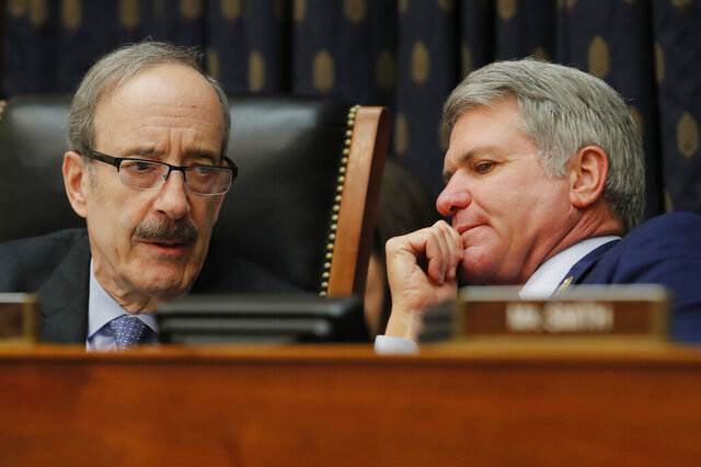 House Foreign Affairs Committee Chairman Eliot Engel, D-N.Y., left, and ranking member Rep. Michael McCaul, R-Texas, talk during a House Foreign Affairs Committee hearing in Washington, Friday, Feb. 28, 2020, as Secretary of State Mike Pompeo testifies. (AP Photo/Carolyn Kaster)
