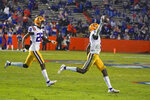 LSU cornerback Jay Ward, right, celebrates with cornerback Darren Evans (26) after intercepting a Florida pass during the first half of an NCAA college football game Saturday, Dec. 12, 2020, in Gainesville, Fla. (AP Photo/John Raoux)