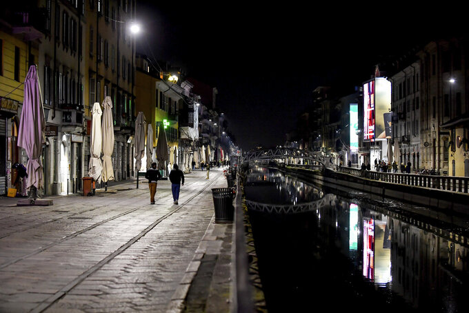 The Navigli district of Milan, one of the area of night life in Milan, is almost deserted after most bars were closed by the last decisions of the government trying to face the coronavirus emergency, in Milan, Sunday, March 8, 2020. (Claudio Furlan/LaPresse via AP)