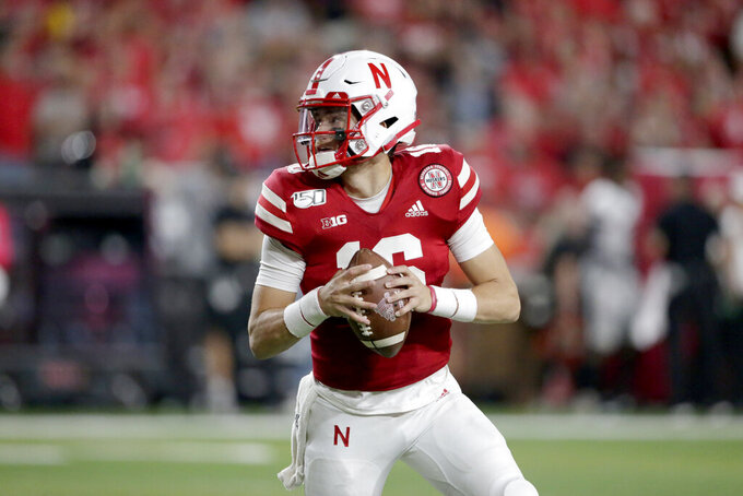 File- In this Sept. 14, 2019 file photo, Nebraska quarterback Noah Vedral (16) looks for a receiver during the second half of an NCAA college football game against Northern Illinois in Lincoln, Neb. Nebraska quarterback Noah Vedral has entered the transfer portal and plans to play his final two seasons at another school, an athletic department spokesman confirmed Tuesday, April 28, 2020. (AP Photo/Nati Harnik, File)