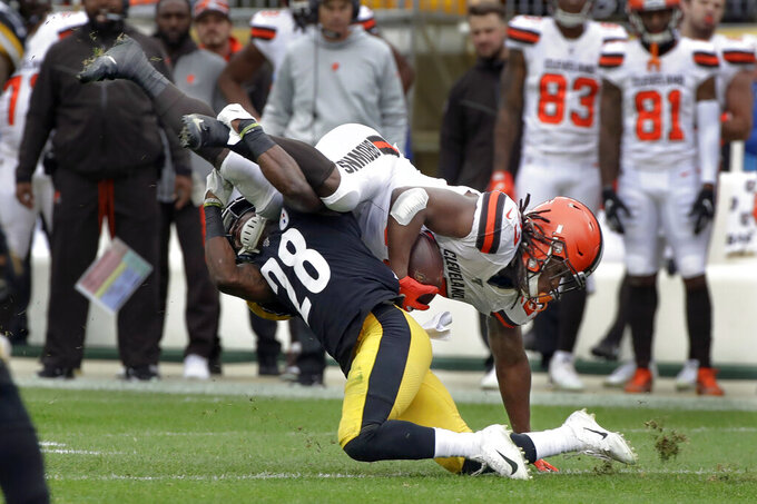 Pittsburgh Steelers cornerback Mike Hilton (28) tackles Cleveland Browns running back Kareem Hunt (27) in the first half of an NFL football game, Sunday, Dec. 1, 2019, in Pittsburgh. (AP Photo/Gene J. Puskar)