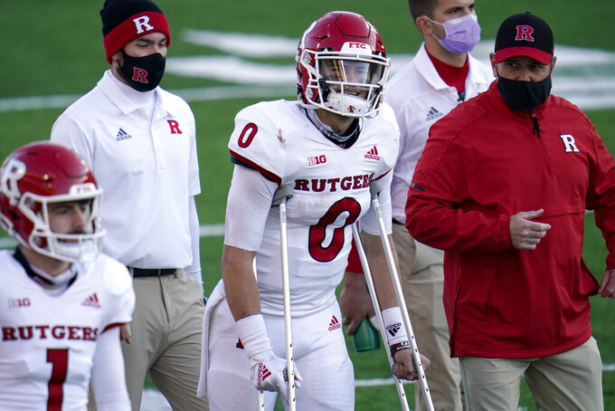 Rutgers quarterback Noah Vedral (0) walks with crutches on the sideline during the second half of an NCAA college football game against Maryland, Saturday, Dec. 12, 2020, in College Park, Md. Rutgers won 27-24 in overtime. (AP Photo/Julio Cortez)