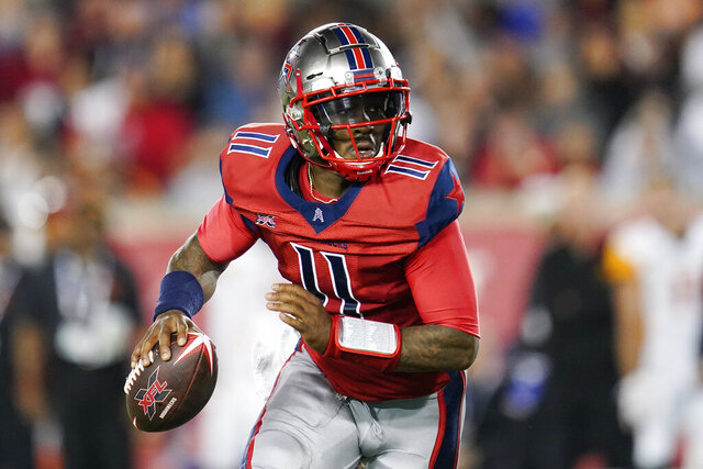 FILE - In this Feb. 8, 2020, file photo, Houston Roughnecks quarterback P.J. Walker (11) looks to pass as he scrambles during an XFL football game in Houston. A person familiar with the situation says the Panthers have agreed to terms on contracts with former XFL quarterback P.J. Walker of the Houston Roughnecks and former Raiders linebacker Tahir Whitehead. The person spoke to the Associated Press on condition of anonymity Monday, March 23, 2020, because the moves have not been announced by the team since the players have yet to pass physicals. (AP Photo/Matt Patterson, File)