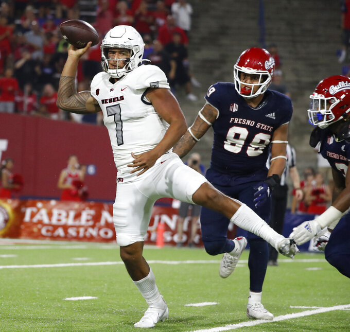 Fresno State defensive end David Perales, right, chases down UNLV quarterback Cameron Friel during the second half of an NCAA college football game in Fresno, Calif., Friday, Sept. 24, 2021. (AP Photo/Gary Kazanjian)