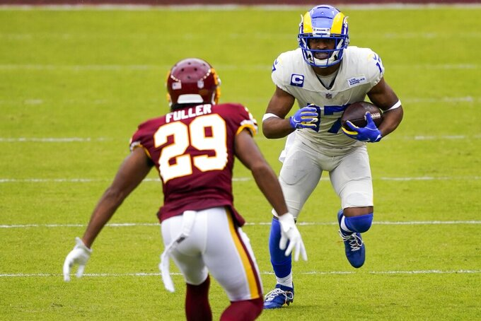Los Angeles Rams' Robert Woods tries to get past Washington Football Team's Kendall Fuller during the first half of an NFL football game Sunday, Oct. 11, 2020, in Landover, Md. (AP Photo/Susan Walsh)