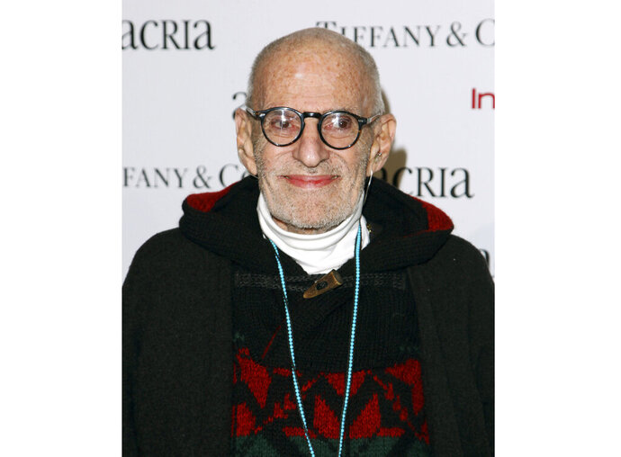 FILE - In this Dec. 10, 2014 file photo, playwright Larry Kramer attends Acria's 19th Annual Holiday Dinner Benefit in New York. Kramer, the playwright whose angry voice and pen raised theatergoers' consciousness about AIDS and roused thousands to militant protests in the early years of the epidemic, died Wednesday, May 27, 2020 in Manhattan of pneumonia. He was 84. (Photo by Donald Traill/Invision/AP, File)