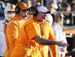 Tennessee head coach Jeremy Pruitt yells to his players in the first half of an NCAA college football game against Vanderbilt, Saturday, Nov. 24, 2018, in Nashville, Tenn. (AP Photo/Mark Humphrey)