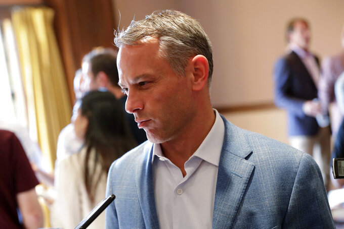 """FILE - Chicago Cubs general manager Jed Hoyer speaks during a media availability during the Major League Baseball general managers annual meetings in Scottsdale, Ariz., in this Tuesday, Nov. 12, 2019, file photo. Cubs president of baseball operations Jed Hoyer indicated the team might conduct more thorough background checks when deciding who to hire in the wake of sexual harassment accusations against former director of pro scouting Jared Porter. Hoyer called the alleged incidents """"disturbing"""" on Monday, Feb. 8, 2021. He said there's """"no place for them in the game,"""" and it's his job to make sure Wrigley Field is a workplace where women can thrive. (AP Photo/Matt York, File)"""