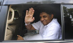 Sri Lanka's main opposition candidate Sajith Premadasa waves as he leaves after voting in the parliamentary election in town Weerawila, Sri Lanka, Wednesday, Aug. 5, 2020. (AP Photo/Tikiribandara Herath )