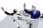 Vice President Mike Pence, left, and Sen. John Cornyn, R-Texas, right, wave as they depart for Washington D.C. from Love Field in Dallas, Sunday, June 28, 2020. (AP Photo/Tony Gutierrez)