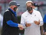 Kentucky coach Mark Stoops, left, and Alabama Head Coach Nick Saban chat before an NCAA college football game at Bryant-Denny Stadium, Saturday, Nov. 21, 2020, in Tuscaloosa, Ala. (Mickey Welsh/The Montgomery Advertiser via AP)