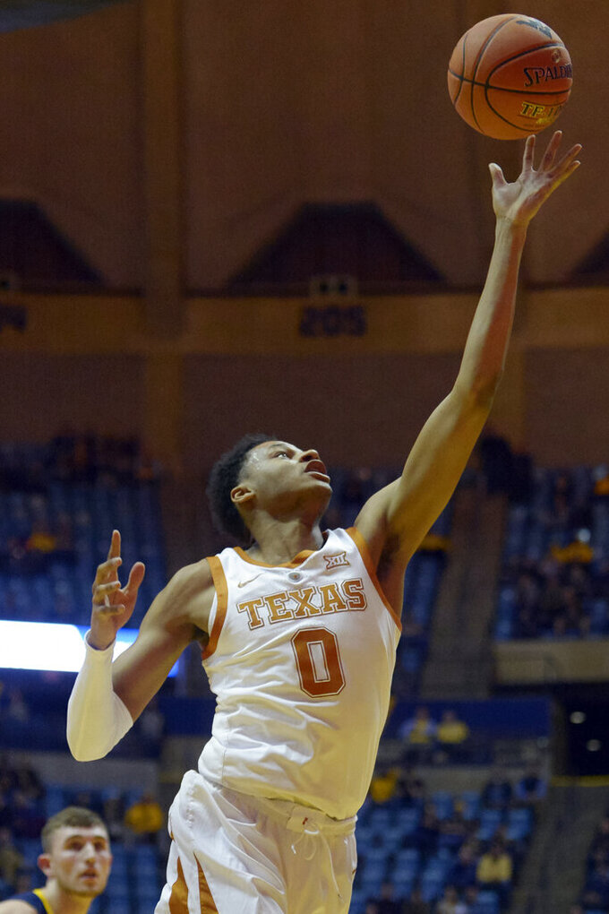 Texas forward Royce Hamm Jr. (5) makes a layup during the second half of an NCAA college basketball game against West Virginia in Morgantown, W.Va., Saturday, Feb. 9, 2019. (AP Photo/Craig Hudson)