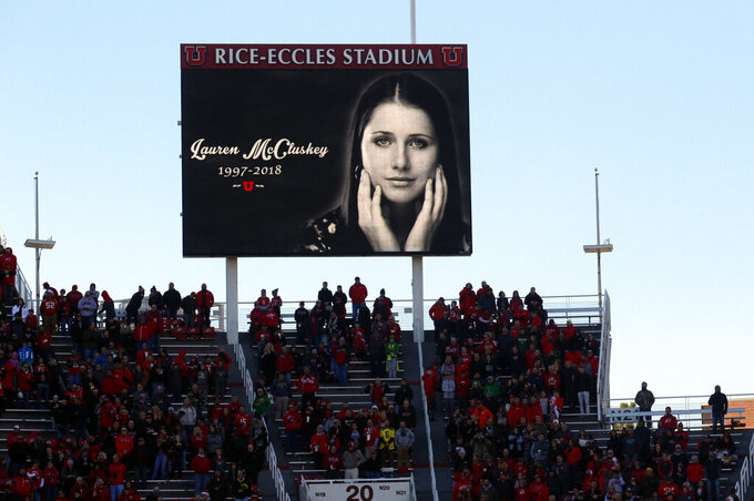 FILE - In this Nov. 10, 2018, file photo, a photograph of University of Utah student and track athlete Lauren McCluskey, who was fatally shot on campus, is projected on the video board before the start of an NCAA college football game between Oregon and Utah in Salt Lake City. The University of Utah plans to spend about $925,000 to improve safety following the killing of the student track athlete on the Salt Lake City campus. (AP Photo/Rick Bowmer, File)