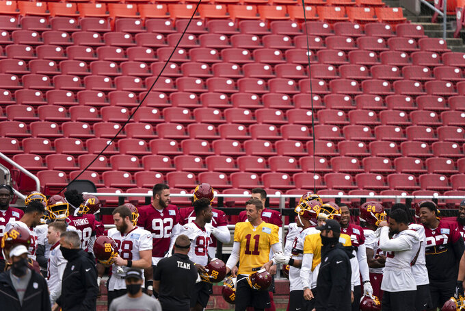 The Washington team gathers, including quarterback Alex Smith (11), for an NFL football practice at FedEx Field, Monday, Aug. 31, 2020, in Washington. (AP Photo/Alex Brandon)