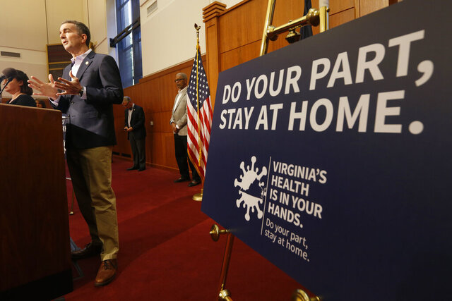 Virginia Gov. Ralph Northam gestures during a news conference at the Capitol Wednesday, April 8, 2020, in Richmond, Va. Northam gave an update on his COVID-19 plans. (AP Photo/Steve Helber)