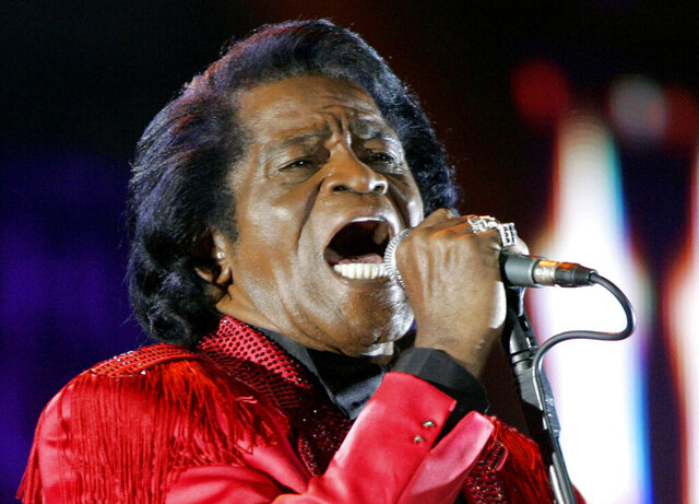 FILE - In this July 6, 2005 file photo,  James Brown performs on stage during the Live 8 concert at Murrayfield Stadium in Edinburgh, Scotland. A prosecutor in Atlanta will decide whether to open a formal investigation after meeting with a woman who says she has evidence the legendary singer's death was caused by another person, his spokesman said. Brown, known as the Godfather of Soul, was 73 when he died of heart failure on Christmas day in 2006 in Atlanta, less than two days after being hospitalized for treatment of pneumonia.   (AP Photo/Matt Dunham, File)