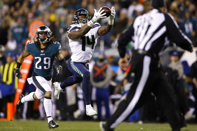 Seattle Seahawks' D.K. Metcalf (14) catches a touchdown pass as Philadelphia Eagles' Avonte Maddox (29) trails during the second half of an NFL wild-card playoff football game, Sunday, Jan. 5, 2020, in Philadelphia. (AP Photo/Matt Rourke)