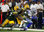 Green Bay Packers' Rashan Gary (52) and Will Redmond (25) bring down Dallas Cowboys' Ezekiel Elliott (21) after a reception during the second half of an NFL football game in Arlington, Texas, Sunday, Oct. 6, 2019. (AP Photo/Ron Jenkins)