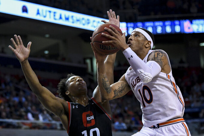 Auburn guard Samir Doughty (10) drives to the basket past Cal State Northridge guard Darius Brown II (10) during the first half of an NCAA college basketball game Friday, Nov. 15, 2019, in Auburn, Ala. (AP Photo/Julie Bennett)