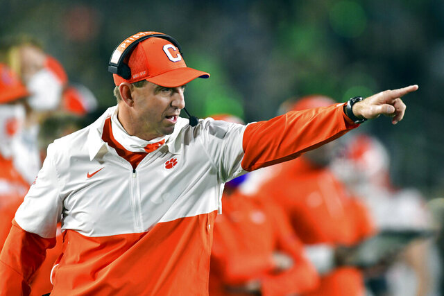 FILE - In this Saturday, Nov. 7, 2020, file photo, Clemson coach Dabo Swinney signals to his players during the second quarter against Notre Dame in an NCAA college football game in South Bend, Ind. Swinney has been critical of Florida State after last weekend's Clemson-FSU game was postponed due to coronavirus concerns. (Matt Cashore/Pool Photo via AP, File)