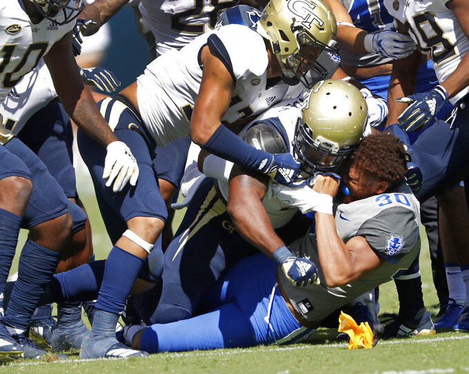 Duke safety Brandon Feamster (30) fights with Georgia Tech players after a kickoff in the first half of the an NCAA college football game, Saturday, Oct. 13, 2018, in Atlanta. (AP Photo/John Bazemore)