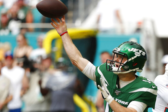 New York Jets quarterback Sam Darnold (14) throws the ball during the first half of an NFL football game against the Miami Dolphins, Sunday, Nov. 3, 2019, in Miami Gardens, Fla. (AP Photo/Wilfredo Lee)