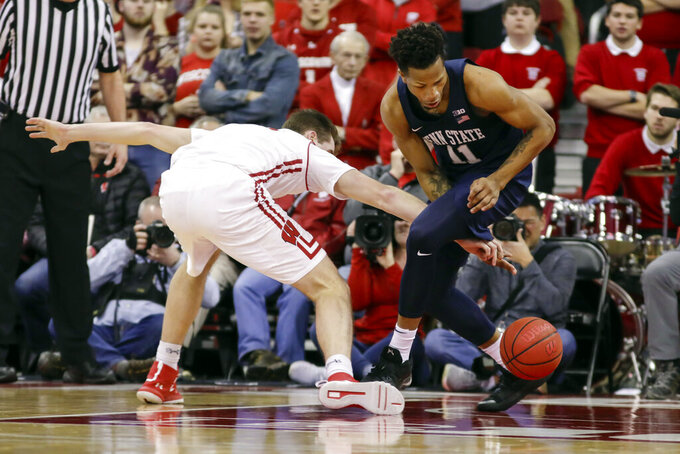 Wisconsin's Nate Reuvers, left, loses control of the ball against Penn State's Lamar Stevens (11) during the first half of an NCAA college basketball game Saturday, March 2, 2019, in Madison, Wis. (AP Photo/Andy Manis)