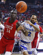 UNLV's Cheikh Mbacke Diong, left, and Nevada's Corey Henson watch the ball while going for a rebound during the first half of an NCAA college basketball game Tuesday, Jan. 29, 2019, in Las Vegas. (AP Photo/John Locher)