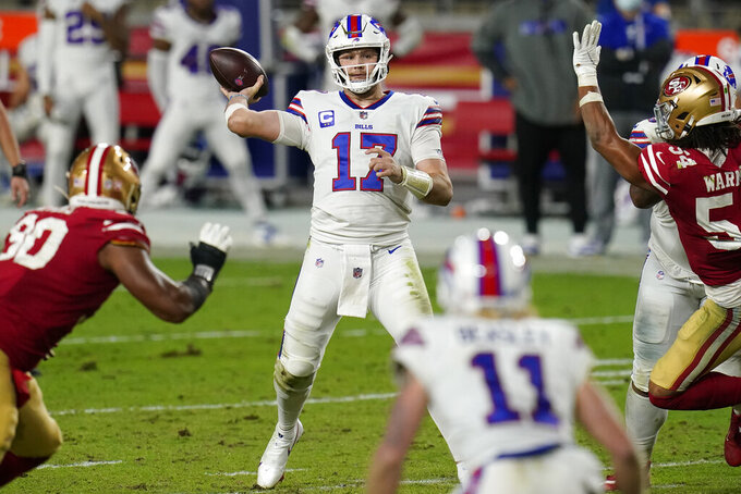 Buffalo Bills quarterback Josh Allen (17) throws against the San Francisco 49ers during the second half of an NFL football game, Monday, Dec. 7, 2020, in Glendale, Ariz. (AP Photo/Ross D. Franklin)
