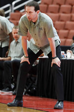 Hawaii coach Eran Ganot watches during first half of the team's NCAA college basketball game against Long Beach State at the Big West men's tournament in Anaheim, Calif., Thursday, March 14, 2019. (AP Photo/Chris Carlson)