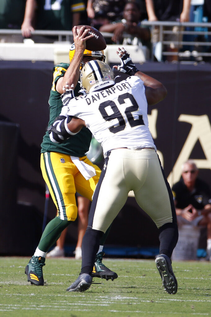 New Orleans Saints defensive end Marcus Davenport (92) sacks Green Bay Packers quarterback Aaron Rodgers during the first half of an NFL football game, Sunday, Sept. 12, 2021, in Jacksonville, Fla. (AP Photo/Stephen B. Morton)