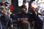 Cleveland Indians' Franmil Reyes is congratulated in the dugout after scoring on a single by Mike Freeman during the third inning of the team's baseball game against the Chicago White Sox on Wednesday, Sept. 25, 2019, in Chicago. (AP Photo/Charles Rex Arbogast)