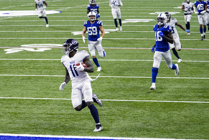 Tennessee Titans wide receiver A.J. Brown (11) runs back an onside kick for a touchdown against the Indianapolis Colts in the second half of an NFL football game in Indianapolis, Sunday, Nov. 29, 2020. (AP Photo/AJ Mast)