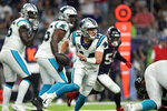 Carolina Panthers quarterback Sam Darnold (14) scrambles out of the pocket against the Houston Texans during the first half of an NFL football game Thursday, Sept. 23, 2021, in Houston. (AP Photo/Eric Christian Smith)