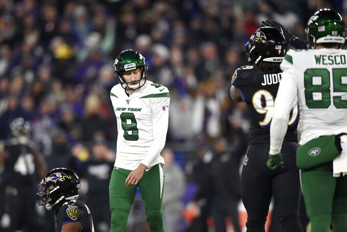 New York Jets kicker Sam Ficken (9) reacts after missing a field goal against the Baltimore Ravens during the first half of an NFL football game, Thursday, Dec. 12, 2019, in Baltimore. (AP Photo/Gail Burton)