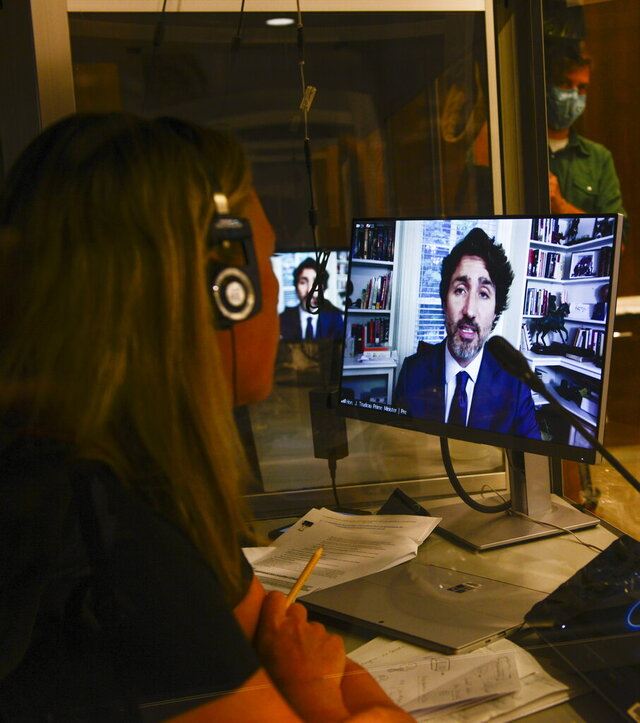 A translator works in their booth as Prime Minister Justin Trudeau appears as a witness via videoconference during a House of Commons finance committee in the Wellington Building on Thursday, July 30, 2020. The committee is looking into Government Spending, WE Charity, and the Canada Student Service Grant. (Sean Kilpatrick/The Canadian Press via AP)
